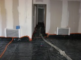 Sheeting out the floor with polythene